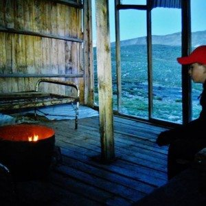 Ginny's son Joel warming up in the abandoned mining shack they spent the night in.